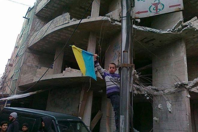 Україна і світ: у Росії пройшов мітинг проти путінських вояк, у США встановили пам'ятник Небесній Сотні, а в Сирії малий хлопчак підняв український прапор…